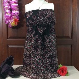 Swishy flirty sheer lined ruffled sleeveless dress